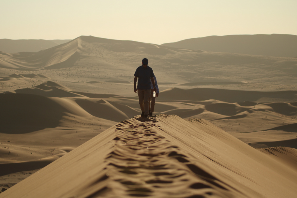 Solo traveller on sand dunes