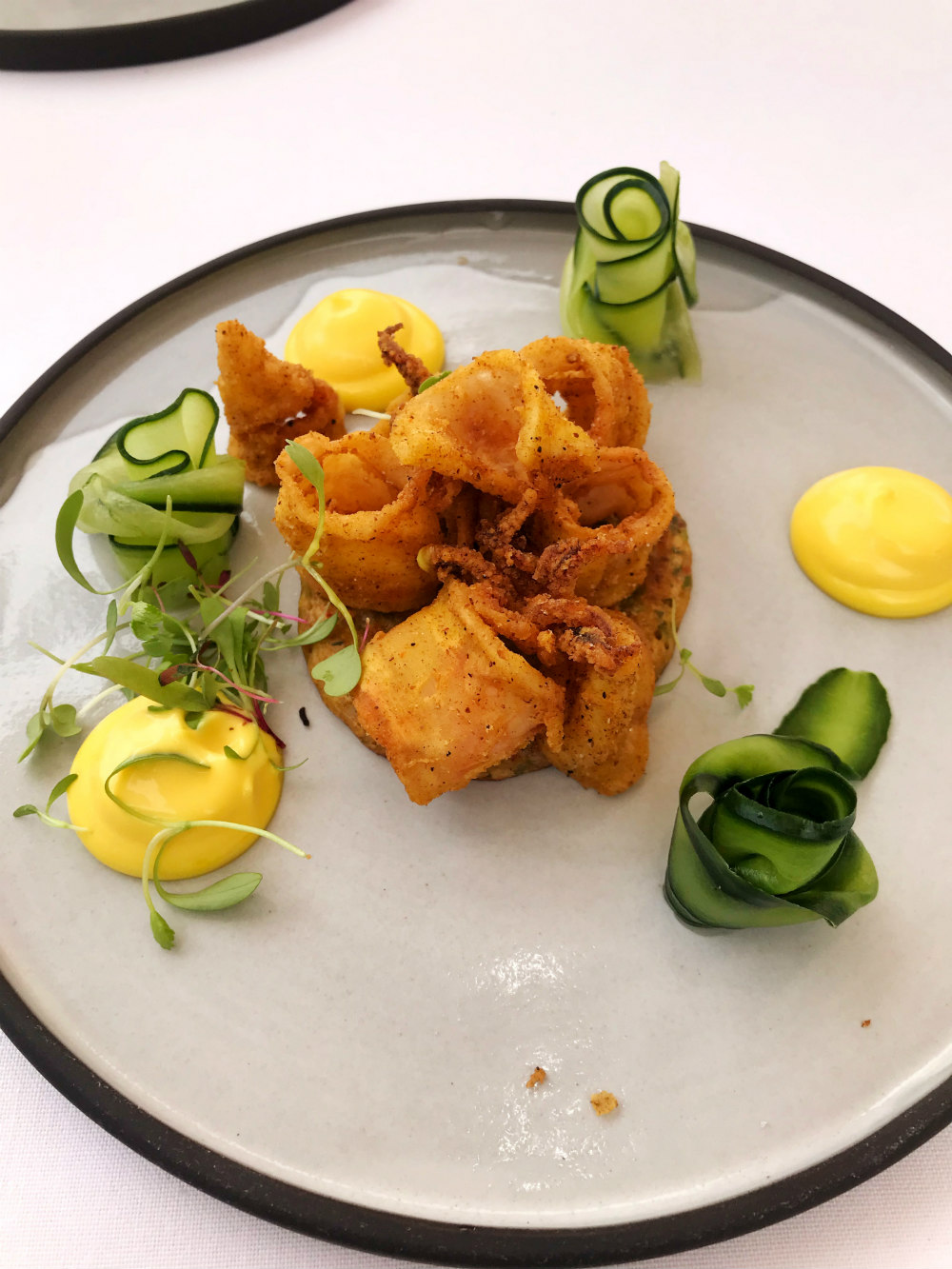 Curry dusted calamari Cucumber ribbons, chilli bite crumpet and rouille