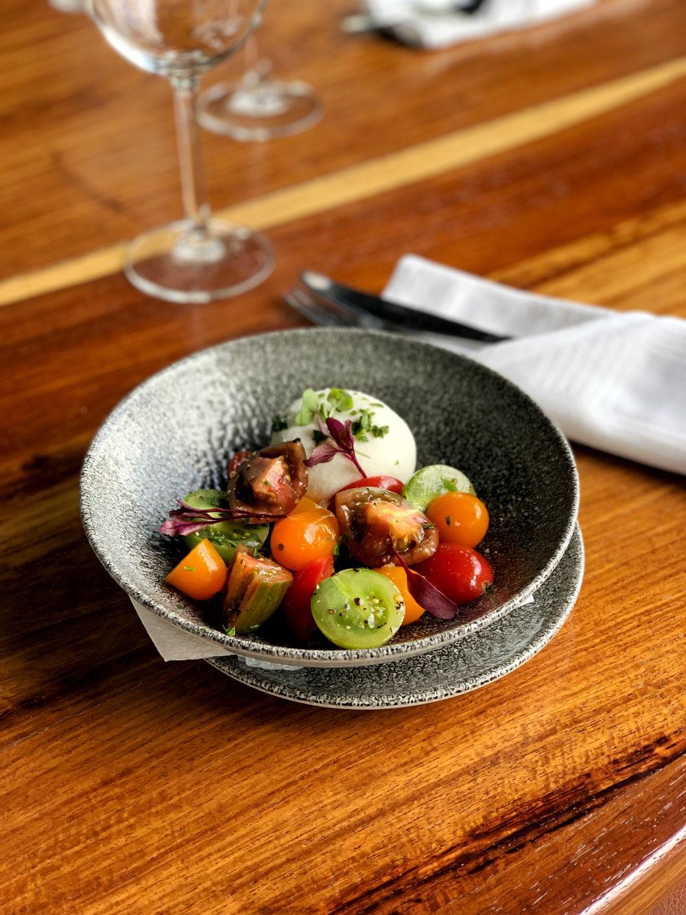 Burrata, exotic tomato salad & honey balsamic dressing.
