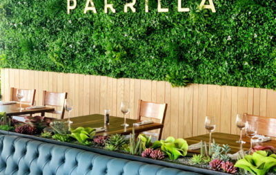 Parillas bar and grill interior sign and garden wall